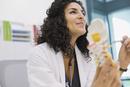 Female doctor explaining spine model