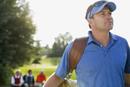 golfer gazing off to next hole challenge