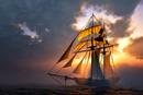 Backlit sailboat against cloudscape at dusk