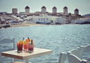 Sea Breeze cocktails on table on seashore, Mykonos, Cyclades, South Aegean, Greece