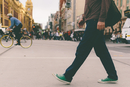 Man in canvas shoes walking in city