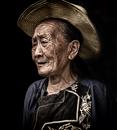 Portrait of elderly farmer woman in sun hat