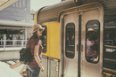 Woman at railway station reflecting in train wagon