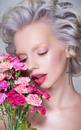 Flower power: beauty portrait of blonde model