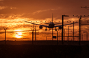 Silhouette of an airplane landing at the airport. Great concept