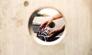 Washing hand seen through hole, Inzai, Kanto, Japan