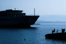 Silhouette of ship and fishermen, Greece