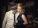 Man flirting with elegant woman in bar