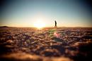 Silhouette of person walking on salt flat, Salar De Uyuni, Potosi, Bolivia