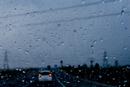 Rain drops on windshield in car