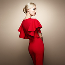 Fashion portrait of elegant woman in red dress