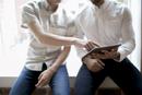 Businessmen reviewing presentation on a tablet