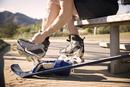 Man putting on roller skates