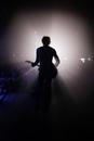 Rock guitarist performing in spotlight