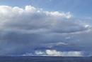 Rain clouds over plain