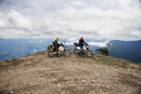 USA, Washington State, Two men driving motocrosses through Gifford Pinchot National Forest