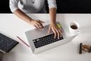 Overhead view of interior designer using laptop at desk