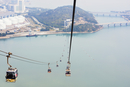 Overhead cable cars over sea during foggy weather