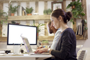 Side view of male and female illustrators working at desk in creative office