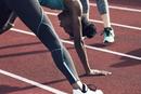 Athletes exercising on track