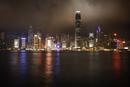 Illuminated Hong King Skyline by Kowloon Bay at night