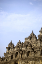 Low angle view of carvings on walls of Prambanan temple against sky