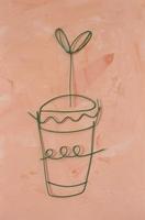 ワイヤーで作った植木鉢と双葉