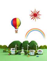 太陽光発電の住宅街と風力発電とエコカーと熱気球
