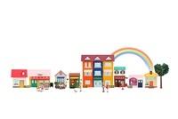 お店が並ぶ街並みと人々と虹