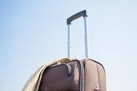旅行鞄と上着