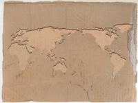 世界地図にくり抜かれた段ボール背景