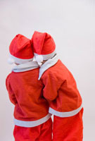 サンタの格好をした兄弟 10154000004| 写真素材・ストックフォト・画像・イラスト素材|アマナイメージズ