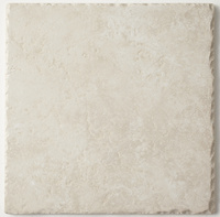 四方削られたベージュ石目のタイル