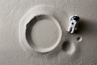 砂とおもちゃの飛行士