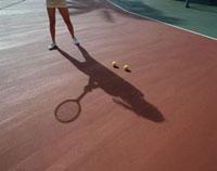 テニスコートで練習する人 グアム