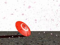 置かれた紅い傘と桜吹雪