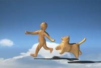 走る木彫りの犬と少年 10361000443| 写真素材・ストックフォト・画像・イラスト素材|アマナイメージズ