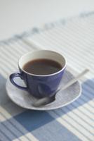 カップアンドソーサーとコーヒー