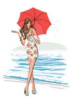 海辺を傘をさして歩く女性