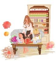 プレゼントにラッピングする女性とソファとソファテーブルと本棚