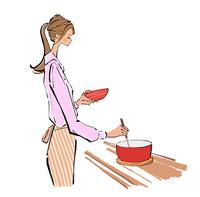 料理をしながら味見をするエプロンをした女性