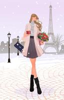 冬のパリの街で、プレゼントと花束を持ち歩く女性