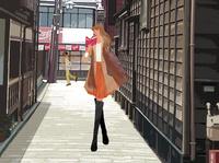 冬の金沢の街を旅行する、本を読みながら歩く女性 10402000084| 写真素材・ストックフォト・画像・イラスト素材|アマナイメージズ
