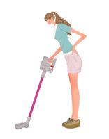 掃除機をかけるポニーテールの女性