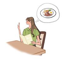 レストランでメニューを見てハンバーグを注文する女性