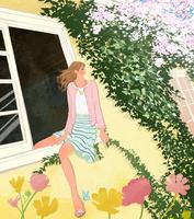 春に窓から身を乗り出して桜の花を見る女の子