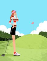 ゴルフ場でドライバーを持ちグリーンを狙うフェアウェイの女性
