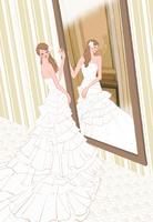 結婚式の前に鏡を見るウェディングドレスの花嫁