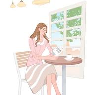 カフェで本を読みながらコーヒーを飲む女性