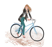 秋冬の服装でパンプスを履き街で自転車に乗る女の子